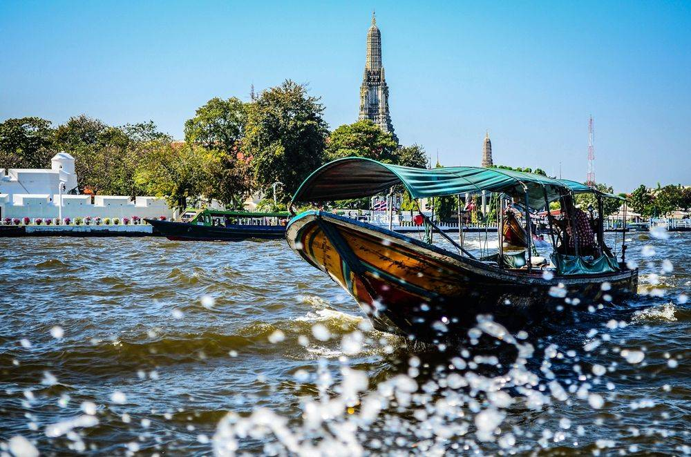 Boat ride along the river to visit temple and relax with massage