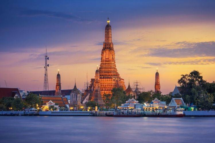 A young night along Chao Phraya river with a long tailed boat