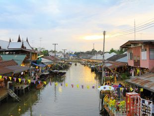 Take A Trip to Maeklong Railway Market and Boating in  Amphawa Floting Market