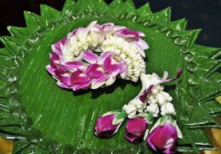 Thai orchid garland and banana leaf tray