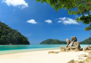 Small peaceful white sandy beach