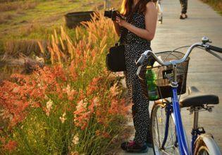 Cycling around the local village Sankhampaeng