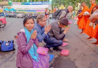 Alms giving - Monks Food Offering local experience