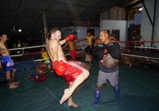 Muay Thai Boxing Training with soldier