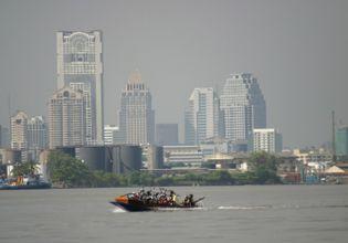 Cross the might Chao Phraya by long tail boat