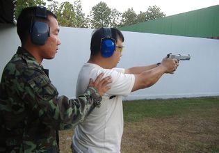 The Shooting Range in the Military Base with an Army Individual Instructor