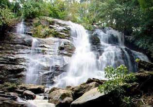 Visit Tat Mok Waterfalls and Interact with Buddhist Monks
