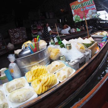 Try local food sold on the paddle boat?