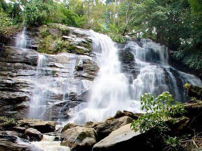 Visit Tat Mok Waterfalls and Interact with Buddhist Monks