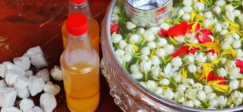 Songkran Festival: Scented water, flowers and silver bowl, traditional beauty of Thai New Year