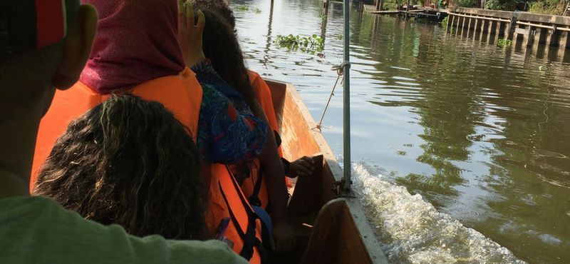 Sightseeing along the Mahasawat Canal in the local boat trip